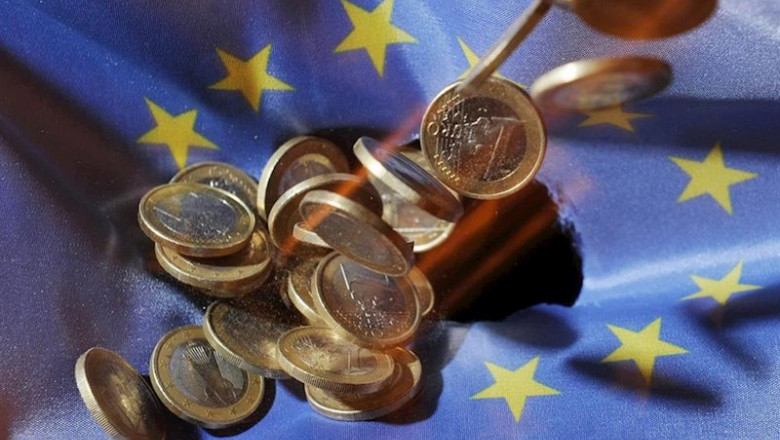 ep filed - 04 july 2011 baden-wuerttemberg karlsruhe one euro coins will fall onto an euflag the
