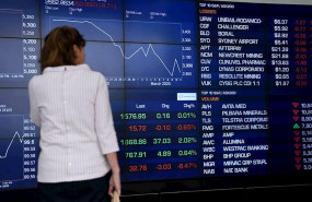 ep a woman looks at the digital market boards at the australian stock exchange asx in sydney friday
